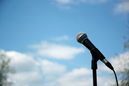 A microphone is hooked up and ready to communicate to the crowd.