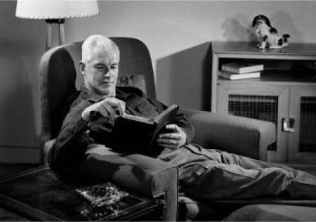 Man reading in armchair
